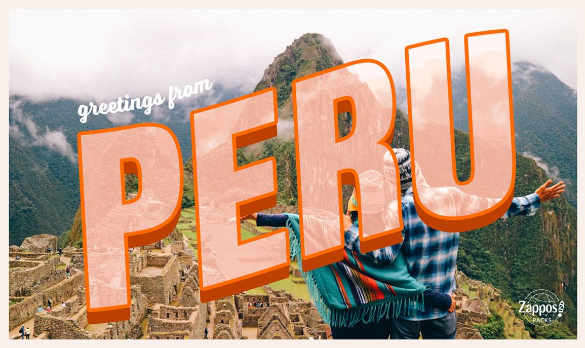 Couple looking out at Machu Picchu, Peru